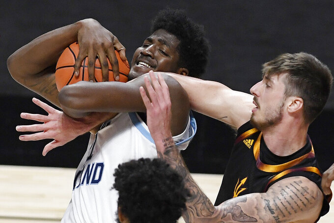 Arizona State's Chris Osten, right, tangles with Rhode Island's Makhi Mitchell, left, in the second half of an NCAA college basketball game, Wednesday, Nov. 25, 2020, in Uncasville, Conn. (AP Photo/Jessica Hill)