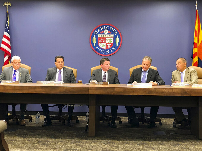 FILE - In this Oct. 23, 2019, file photo, the Maricopa County Board of Supervisors meets in Phoenix. Steve Chucri, second from left, a Republican official in Arizona resigned Tuesday, Sept. 21, 2021, from the board overseeing Maricopa County after a recording emerged of him criticizing his GOP colleagues for opposing a review of the 2020 election. (AP Photo/Jonathan J. Cooper, File)