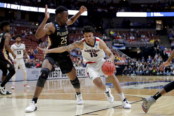 Gonzaga forward Brandon Clarke, right, drives to the basket around Florida State forward Mfiondu Kabengele during the first half an NCAA men's college basketball tournament West Region semifinal Thursday, March 28, 2019, in Anaheim, Calif. (AP Photo/Jae C. Hong)