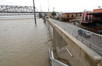 As the Atchafalaya River continues to rise due to the rains of Tropical Storm Barry, it becomes harder to see the Morgan City name on the sea wall, Saturday, July 13, 2019, in Morgan City, La. (AP Photo/Rogelio V. Solis)