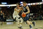 Xavier forward Jason Carter, right, drives into Wake Forest forward Ismael Massoud in the second half of an NCAA college basketball game in Winston-Salem, N.C., Saturday, Dec. 14, 2019.  (AP Photo/Nell Redmond)