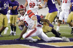 Utah quarterback Jake Bentley keeps the ball for a touchdown against Washington during the first half of an NCAA college football game Saturday, Nov. 28, 2020, in Seattle. (AP Photo/Ted S. Warren)