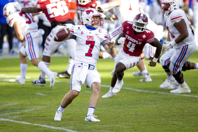 SMU quarterback Shane Buechele (7) looks to pass during the second half of an NCAA college football game against Temple, Saturday, Nov. 7, 2020, in Philadelphia. SMU won 47-23. (AP Photo/Laurence Kesterson)
