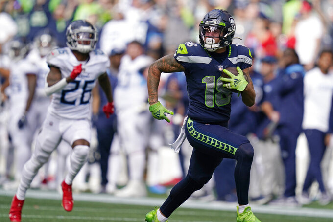 Seattle Seahawks wide receiver Freddie Swain runs for a touchdown after a reception against the Tennessee Titans during the second half of an NFL football game, Sunday, Sept. 19, 2021, in Seattle. (AP Photo/Elaine Thompson)