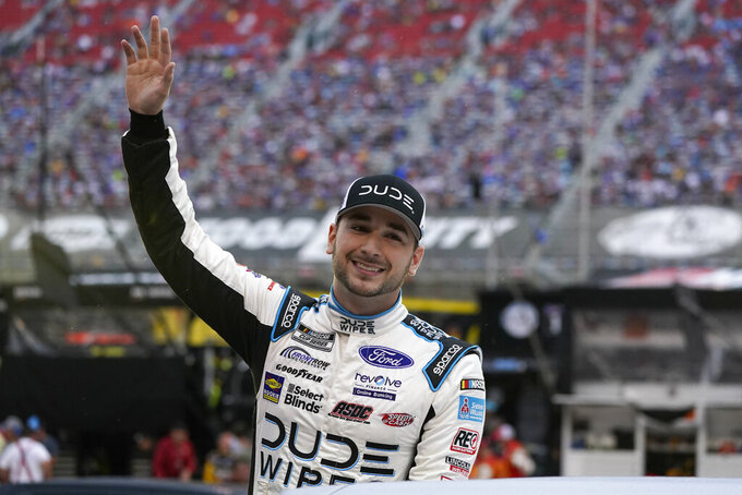 Anthony Alfredo waves to fans before a NASCAR Cup Series auto race at Bristol Motor Speedway Saturday, Sept. 18, 2021, in Bristol, Tenn. (AP Photo/Mark Humphrey)