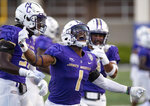 James Madison safety Que Reid (1) celebrates after making an interception against Morehead State during the first half of an NCAA college football game in Harrisonburg, Va., Saturday, Sept. 4, 2021. (Daniel Lin/Daily News-Record via AP)