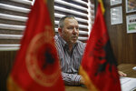 Hysni Gucati head of the War Veterans Organization of the Kosovo Liberation Army speaks during an interview with The Associated Press regarding his co-fighter former Kosovo Liberation Army commander Salih Mustafa after news of his arrest, in capital Pristina, Thursday, Sept. 24, 2020. A special international court said Thursday that a former commander of the separatist fighters in Kosovo's 1998-1999 war has been arrested as part of a war crimes and crimes against humanity probe stemming from the conflict with Serbia. (AP Photo/Visar Kryeziu)