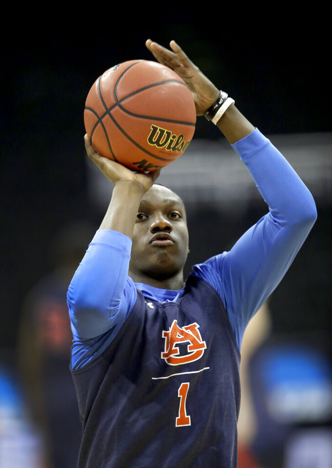 Auburn's Jared Harper shoots during practice at the NCAA men's college basketball tournament Thursday, March 28, 2019, in Kansas City, Mo. Auburn plays North Carolina in a Midwest Regional semifinal on Friday. (AP Photo/Charlie Riedel)