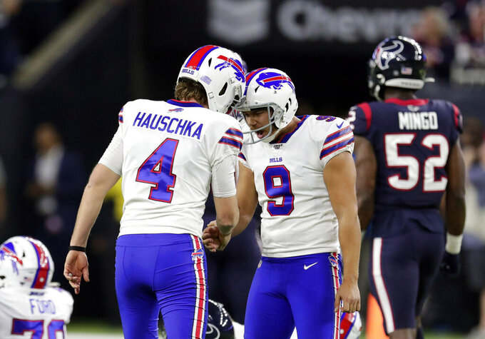 Buffalo Bills kicker Stephen Hauschka (4) celebrates with Corey Bojorquez (9) after kicking a field to tie the game during the second half of an NFL wild-card playoff football game against the Houston Texans Saturday, Jan. 4, 2020, in Houston. (AP Photo/Michael Wyke)