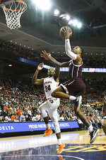 Auburn forward Anfernee McLemore (24) defends a shot by Texas A&M guard Savion Flagg (1) during the first half of an NCAA college basketball game Wednesday, March 4, 2020, in Auburn, Ala. (AP Photo/Julie Bennett)