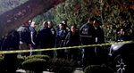 Police gather outside a residence in Monsey, N.Y., early Sunday, Dec. 29, 2019, following a stabbing Saturday during a Hanukkah celebration. Authorities say that several people were stabbed north of New York City late Saturday night and a possible suspect has been located. The Orthodox Jewish Public Affairs Council for the Hudson Valley region tweeted reports that the stabbing took place at the house of a Hasidic rabbi while they were celebrating Hanukkah. (Seth Harrison/The Journal News via AP)