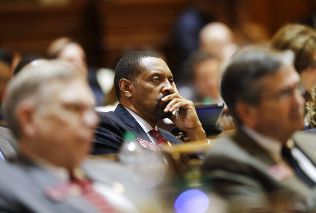 FILE - In this Jan. 11, 2017, file photo, Rep. Vernon Jones listens as Georgia Gov. Nathan Deal delivers the State of the State address on the House floor in Atlanta. Jones, a polarizing Democratic state lawmaker in Georgia, broke party ranks on Tuesday, April 14, 2020, to endorse President Donald Trump's reelection. Jones, who represents portions of metro Atlanta's DeKalb and Rockdale counties, told the Atlanta Journal-Constitution that he's supporting Trump because of the Republican president's handling of the economy and his criminal justice reform efforts. (AP Photo/David Goldman, File)