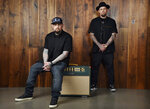 In this Tuesday, July 10, 2018, photo, Benji Madden, left, and his twin brother Joel Madden of the band Good Charlotte pose for a portrait, in Burbank, Calif. The city of Annapolis, Md. will hold a benefit concert on July 28 featuring the Maryland-based band to honor the five Capital Gazette employees killed in an attack in their newsroom. (Photo by Chris Pizzello/Invision/AP)