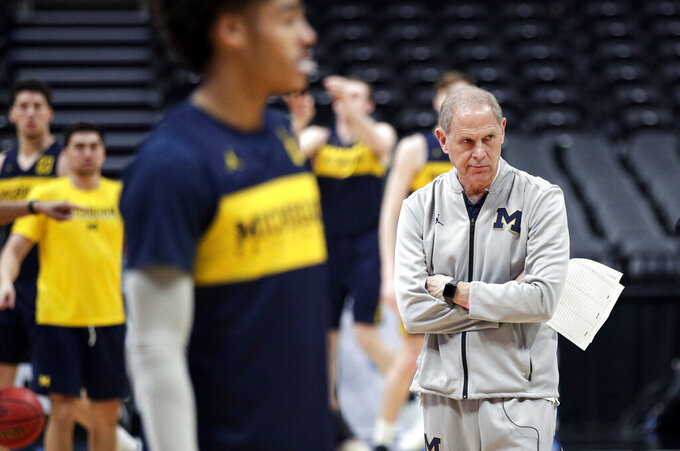 Michigan head coach John Beilein, right, watches during practice at the NCAA men's college basketball tournament in Anaheim, Calif., Wednesday, March 27, 2019. Michigan plays Texas Tech in a West Regional semifinal on Thursday. (AP Photo/Jae C. Hong)