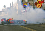 Red Bull Racing driver Max Verstappen does doughnuts along Hollywood Boulevard in front of the Hard Rock Cafe in the Hollywood section of Los Angeles on Wednesday, Oct. 30, 2019. The street was thronged with thousands of fans craning for a glimpse of the drivers whose sport has worldwide popularity, but makes a relatively small imprint on the lucrative U.S. market. With the United States Grand Prix in Texas this weekend, the drivers were eager to raise F1's profile on the West Coast. (AP Photo/Richard Vogel)