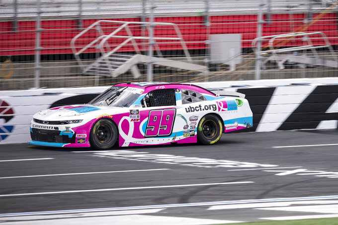 NASCAR Xfinity Series driver J.J. Yeley (99) races during the NASCAR Xfinity auto race at the Charlotte Motor Speedway Saturday, Oct. 9, 2021, in Concord, N.C. (AP Photo/Matt Kelley)