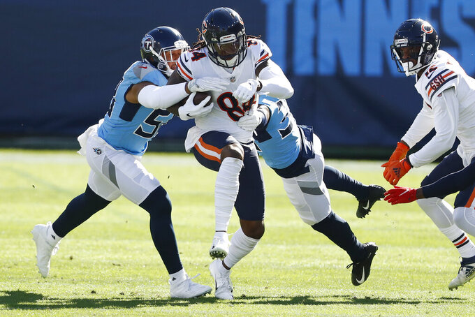 Chicago Bears wide receiver Cordarrelle Patterson (84) gets caught by Tennessee Titans defenders in the first half of an NFL football game Sunday, Nov. 8, 2020, in Nashville, Tenn. (AP Photo/Wade Payne)
