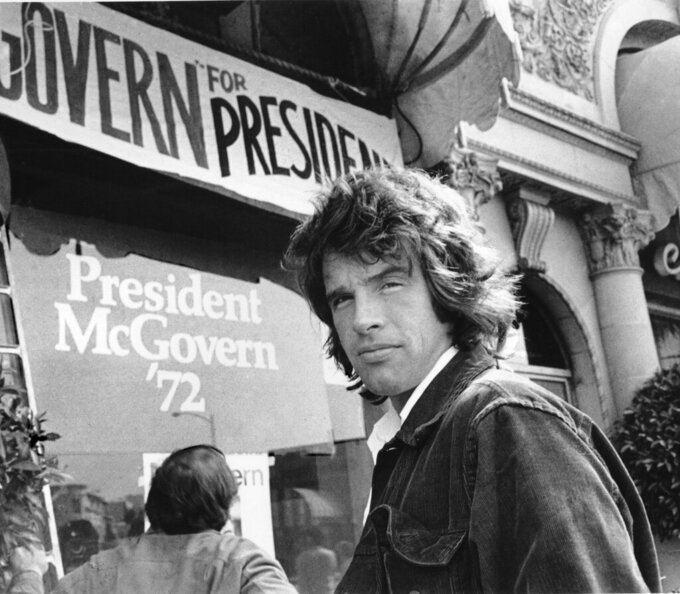 "FILE - In this May 29, 1972, file photo, actor Warren Beatty stands outside the headquarters for Democratic presidential candidate U.S. Sen. George McGovern in Beverly Hills, Calif. Years before Jared Goff or any of today's Los Angeles Rams were born, Beatty had been carried off on his teammates' shoulders to celebrate a Rams title that only Hollywood could dream up. He played quarterback Joe Pendleton in the 1978 Academy Award nominated movie ""Heaven Can Wait."" At the end, he leads LA to an otherworldly Super Bowl victory over the Steelers. (AP Photo, File)"