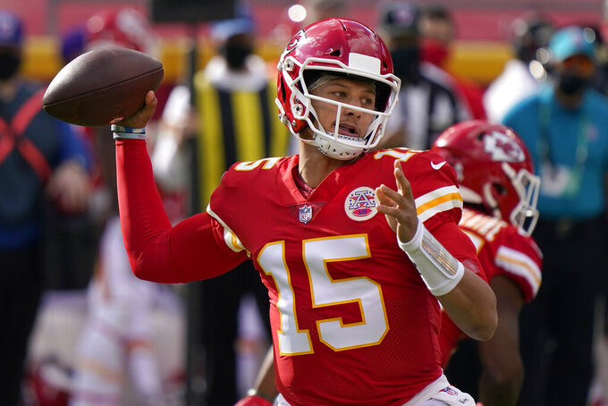 Kansas City Chiefs quarterback Patrick Mahomes (15) passes against the Carolina Panthers during the first half of an NFL football game in Kansas City, Mo., Sunday, Nov. 8, 2020. (AP Photo/Jeff Roberson)