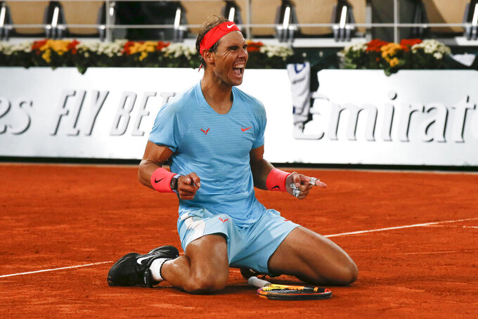 FILE - Spain's Rafael Nadal celebrates winning the final match of the French Open tennis tournament against Serbia's Novak Djokovic in three sets, 6-0, 6-2, 7-5, at the Roland Garros stadium in Paris, France, in this Sunday, Oct. 11, 2020, file photo.  The AP has put together a quiz for you to test your knowledge before the clay-court major championship begins Sunday. (AP Photo/Michel Euler, File)