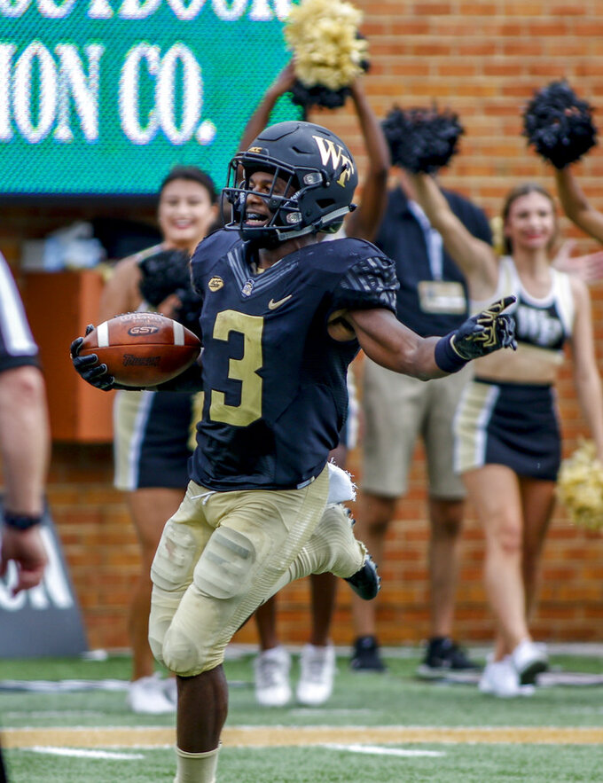 FILE - In this Sept. 8, 2018, file photo, Wake Forest punt returner Greg Dortch reacts after scoring a touchdown on a punt return against Towson in the first half of a NCAA college football game, in Winston-Salem, N.C. Dortch was named to The Associated Press Midseason All-America team, Tuesday, Oct. 16, 2018. (AP Photo/Nell Redmond, File)