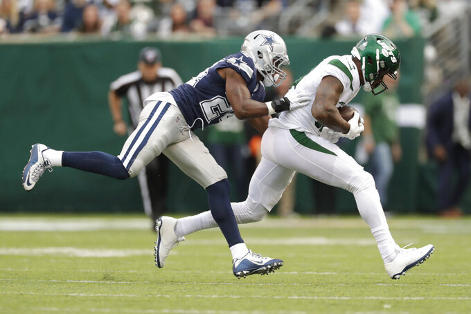 Dallas Cowboys' Chidobe Awuzie, left, tackles New York Jets' Demaryius Thomas during the first half of an NFL football game, Sunday, Oct. 13, 2019, in East Rutherford, N.J. (AP Photo/Adam Hunger)