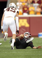 CORRECTS TO AUG. 30, 2018, NOT AUG. 31, 2018 - New Mexico State quarterback Matt Romero (3) falls after a tackle by Minnesota linebacker Carter Coughlin (45) during the first half of an NCAA college football game Thursday, Aug. 30, 2018, in Minneapolis. (AP Photo/Stacy Bengs)