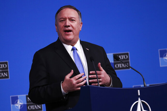 U.S. Secretary of State Mike Pompeo talks to journalists during a news conference during a NATO Foreign Ministers meeting at the NATO headquarters in Brussels, Wednesday, Nov. 20, 2019. (AP Photo/Francisco Seco)