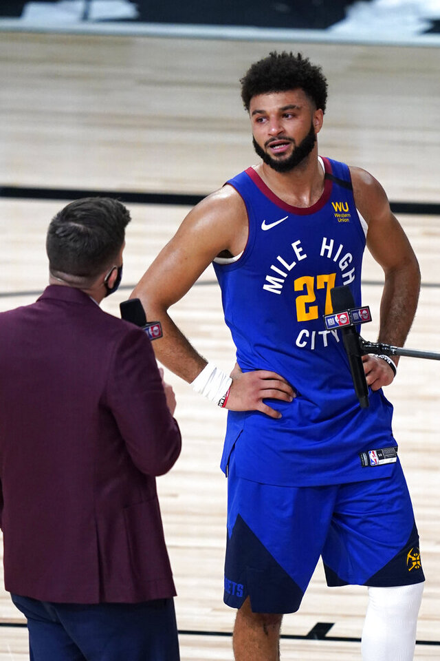Denver Nuggets' Jamal Murray (27) becomes emotional during an interview after an NBA basketball first round playoff game against the Utah Jazz Sunday, Aug. 30, 2020, in Lake Buena Vista, Fla. The Nuggets won 119-107. (AP Photo/Ashley Landis)