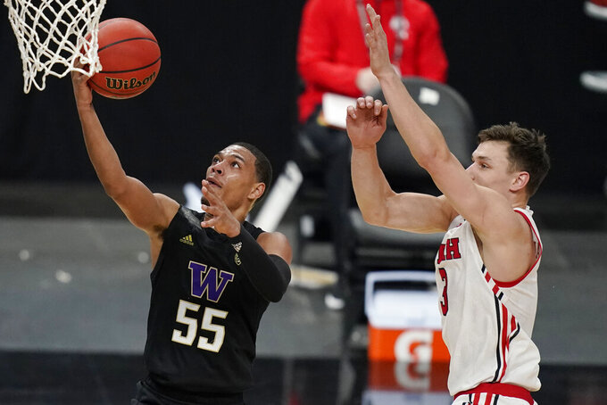 Washington's Quade Green (55) shoots around Utah's Pelle Larsson (3) during the first half of an NCAA college basketball game in the first round of the Pac-12 men's tournament Wednesday, March 10, 2021, in Las Vegas. (AP Photo/John Locher)