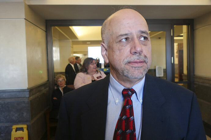 Kansas House Minority Leader Tom Sawyer, D-Wichita, answers questions from reporters as he prepares to depart from the Statehouse to a U.S. Department of Homeland Security briefing at a former Air Force base, Tuesday, Jan. 14, 2020, in Topeka, Kan. Sawyer later called the briefing