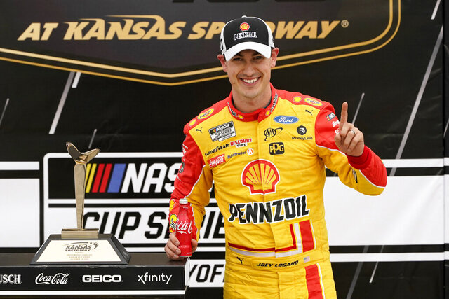 Joey Logano celebrates in victory lane after winning a NASCAR Cup Series auto race at Kansas Speedway in Kansas City, Kan., Sunday, Oct. 18, 2020. (AP Photo/Orlin Wagner)