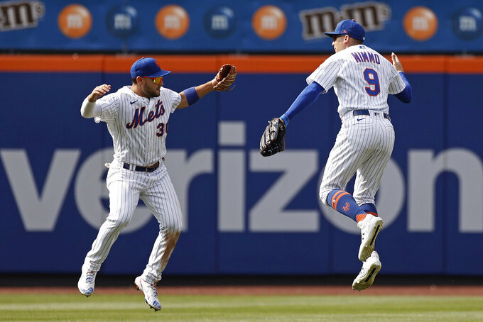 New York Mets right fielder Michael Conforto and center fielder Brandon Nimmo (9) celebrate after they defeated the Toronto Blue Jays in a baseball game Sunday, July 25, 2021, in New York. (AP Photo/Adam Hunger)