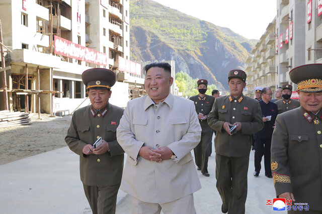In this undated photo provided on Wednesday, Oct. 14, 2020, by the North Korean government, North Korean leader Kim Jong Un, second from left, visits the typhoon-ravaged rural town of Komdok, North Korea, to inspect recovery works. Kim's inspection was his first public activity after weekend celebrations marking his ruling party's founding anniversary. Independent journalists were not given access to cover the event depicted in this image distributed by the North Korean government. The content of this image is as provided and cannot be independently verified. Korean language watermark on image as provided by source reads: