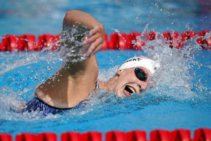 FILE - In this April 11, 2021, file photo, Katie Ledecky competes in the women's 1500-meter freestyle final at the TYR Pro Swim Series swim meet in Mission Viejo, Calif. Ledecky finished first. (AP Photo/Ashley Landis, File)