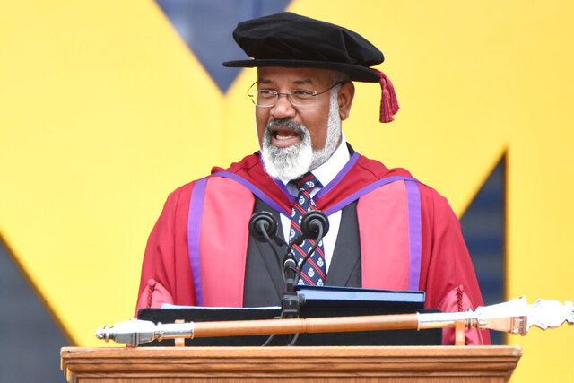 FILE - In this May, 4, 2019, file photo, University of Michigan Provost Martin Philbert speaks during commencement exercises in Ann Arbor, Mich. The University of Michigan paid nearly $200,000 to settle a lawsuit alleging that Philbert wrongly laid off an employee partly because he preferred to keep on a female researcher with whom he allegedly had an inappropriate relationship, according to terms of the settlement released Monday, Feb. 17, 2020. (Max Ortiz/Detroit News via AP, File)