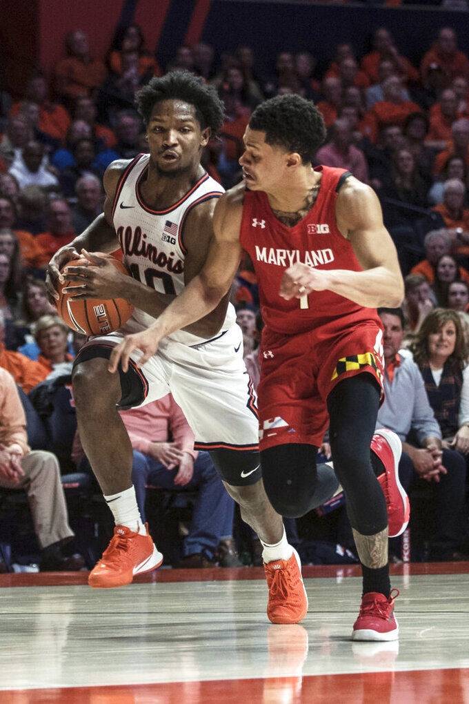 Illinois' Andres Feliz (10) drives the ball while pressured by Maryland's Anthony Cowan Jr. (1) during the first half of an NCAA college basketball game Friday, Feb. 7, 2020, in Champaign, Ill. (AP Photo/Holly Hart)