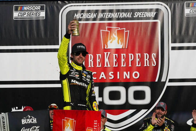 Ryan Blaney celebrates his win after the NASCAR Cup Series auto race at Michigan International Speedway, Sunday, Aug. 22, 2021, in Brooklyn, Mich. (AP Photo/Carlos Osorio)