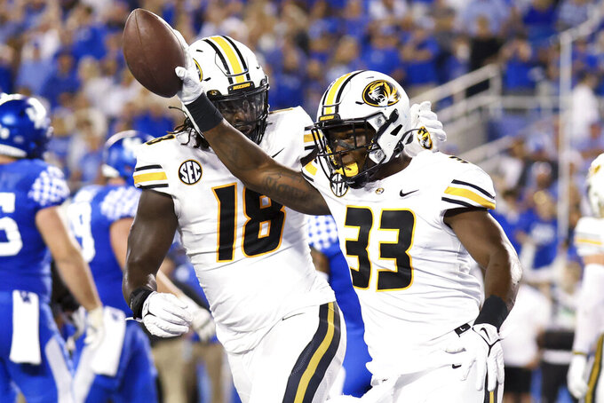 Missouri linebacker Chad Bailey (33) picks up a Kentucky fumble near the end zone during the first half of an NCAA college football game in Lexington, Ky., Saturday, Sept. 11, 2021. (AP Photo/Michael Clubb)