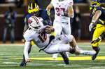 Wisconsin quarterback Alex Hornibrook (12) is sacked by Michigan linebacker Devin Bush (10) during the first quarter of an NCAA college football game in Ann Arbor, Mich., Saturday, Oct. 13, 2018. (AP Photo/Tony Ding)