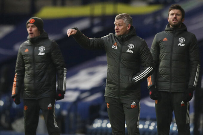 Manchester United's manager Ole Gunnar Solskjaer, center, gives instructions from the side line during the English Premier League soccer match between West Bromwich Albion and Manchester United at the Hawthorns stadium in West Bromwich, England, Sunday, Feb. 14, 2021. (Naomi Baker/Pool Photo via AP)