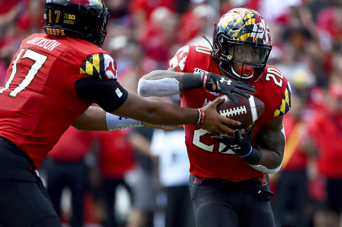 Jackson sharp as Maryland blows out No. 21 Syracuse 63-20