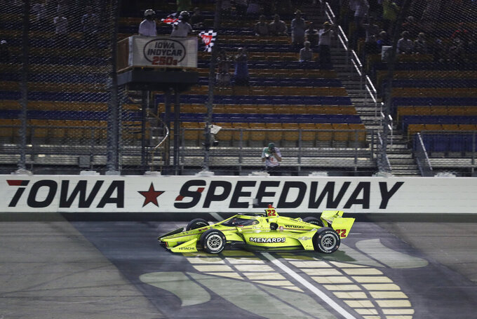 Simon Pagenaud, of France, crosses the finish line as he wins an IndyCar Series auto race Friday, July 17, 2020, at Iowa Speedway in Newton, Iowa. (AP Photo/Charlie Neibergall)