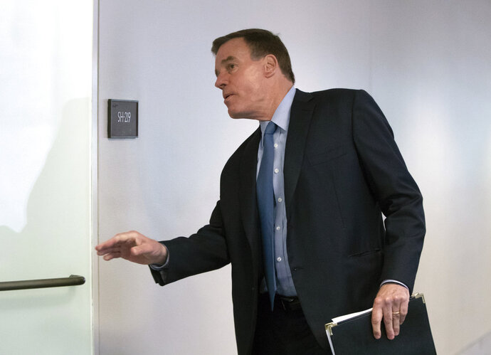 Senate Intelligence Committee Vice Chairman Mark Warner, D-Va., goes behind closed doors as members of the Senate Intelligence Committee arrive to vote on Gina Haspel, President Donald Trump's pick to lead the Central Intelligence Agency, on Capitol Hill in Washington, Wednesday, May 16, 2018. In announcing his support for the nominee, Warner said Haspel has been