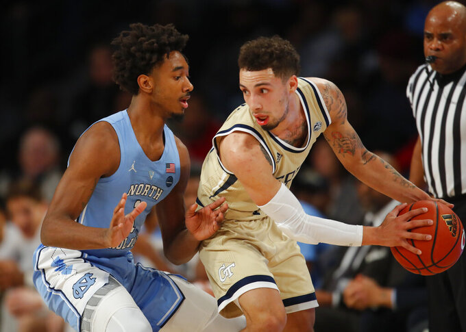 Georgia Tech  guard Jose Alvarado (10) looks to pass as he is defended by North Carolina  guard Leaky Black (1) during the first half of an NCAA college basketball game in Atlanta, Tuesday, Jan. 29, 2019. (AP Photo/Todd Kirkland)
