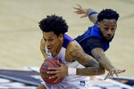 Tulsa's Keyshawn Embery-Simpson, right, tries to steal the ball from TCU's Taryn Todd during the second half of an NCAA college basketball game Saturday, Nov. 28, 2020, in Kansas City, Mo. (AP Photo/Charlie Riedel)