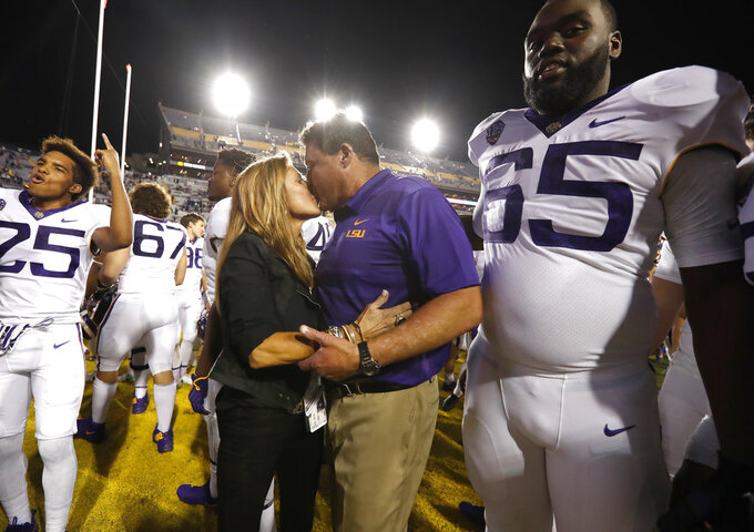 LSU head coach Ed Orgeron and his wife Kelly celebrate a victory after an NCAA college football game against Mississippi State in Baton Rouge, La., Saturday, Oct. 20, 2018. LSU won 19-3. (AP Photo/Tyler Kaufman)
