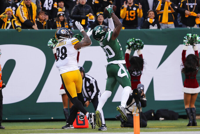 New York Jets free safety Marcus Maye (20) intercepts the ball in front of Pittsburgh Steelers running back Jaylen Samuels (38) during the first half of an NFL football game, Sunday, Dec. 22, 2019, in East Rutherford, N.J. (AP Photo/Seth Wenig)