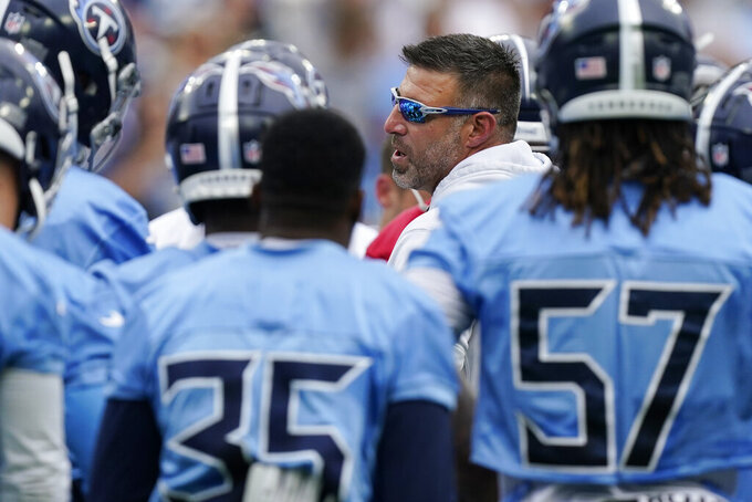 Tennessee Titans head coach Mike Vrabel talks to his players during NFL football training camp Monday, Aug. 16, 2021, in Nashville, Tenn. (AP Photo/Mark Humphrey)