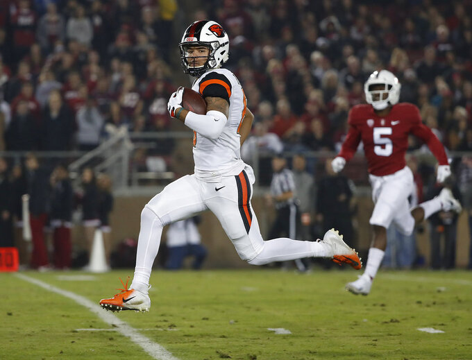 Oregon State wide receiver Trevon Bradford (8) runs for a touchdown against Stanford in the first half during an NCAA college football game on Saturday, Nov. 10, 2018, in Stanford, Calif. (AP Photo/Tony Avelar)